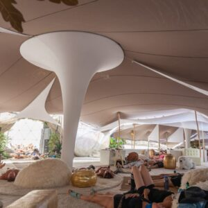 Tension Fabric column covers in tent stretch fabric shapes tensioned as decor and soft sculpture
